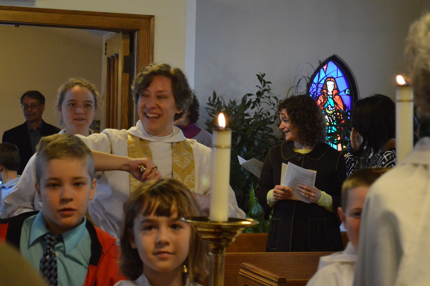 Remember your Baptism! Joyful Easter worshippers are sprinkled with Holy Water.